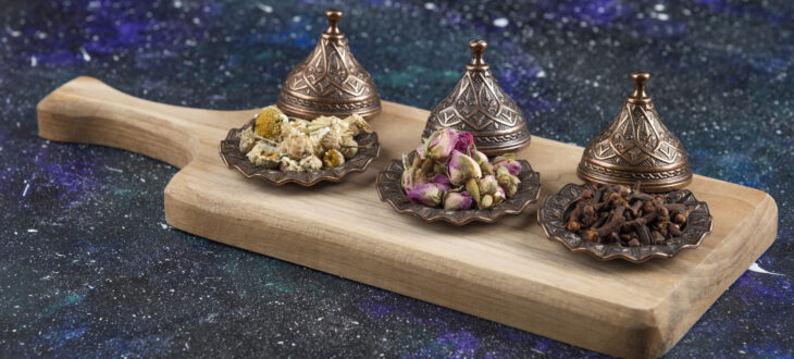 Different herbs and spices on wooden board. High quality photo
