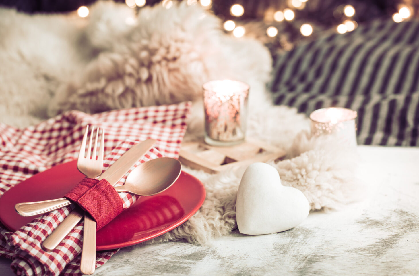 Valentine's Day, festive dinner on a wooden background cutlery in a cozy homely atmosphere
