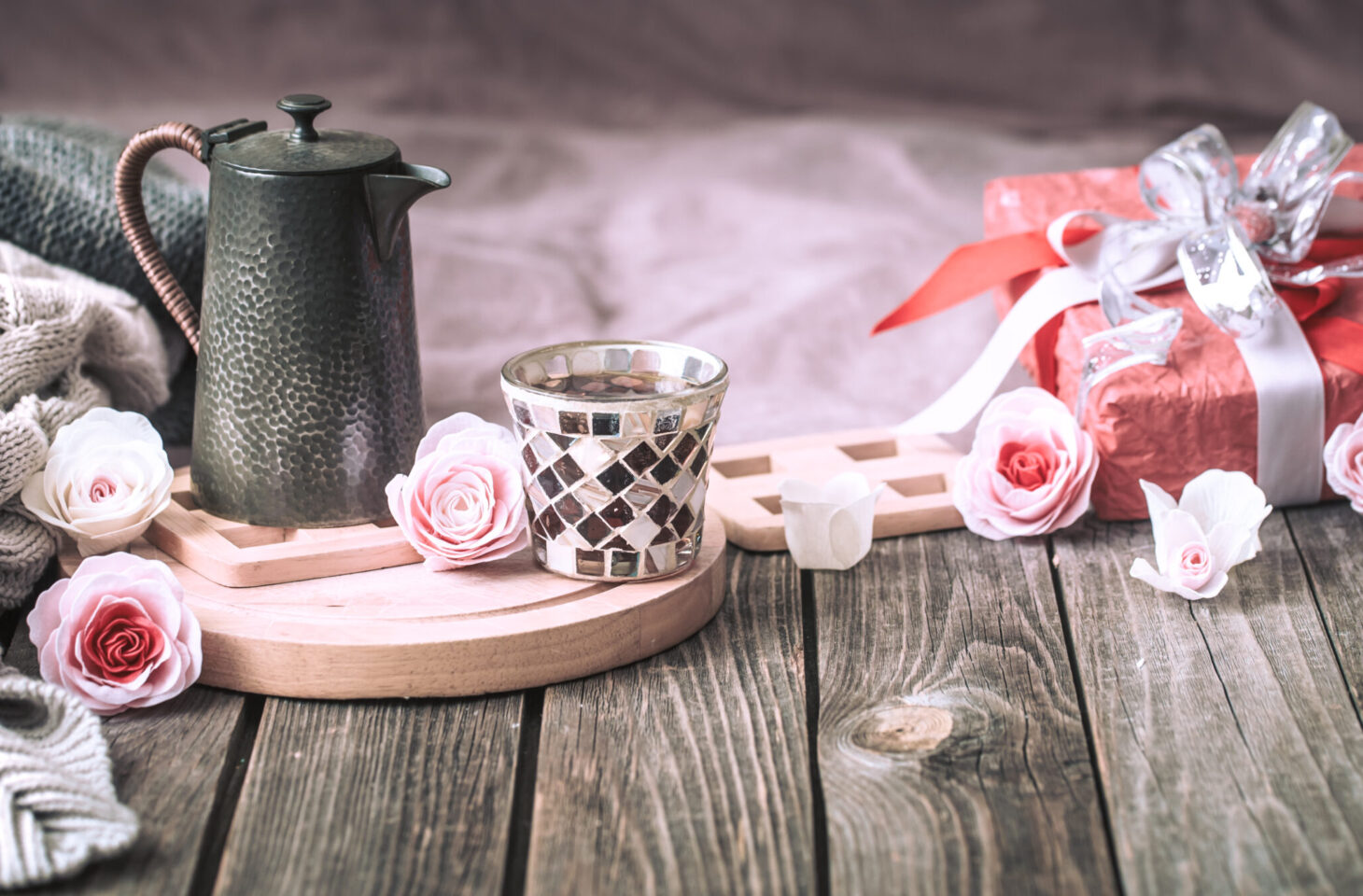 Concept for Valentine's Day or Mother's Day, a festive still life with tea and a teapot on a wooden table in the living room at home